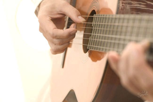 Як навчитися грати на гітарі